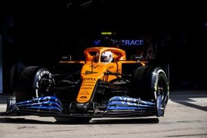 Lando Norris, McLaren MCL35, leaves the garage