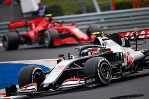 Kevin Magnussen, Haas VF-20, leads Charles Leclerc, Ferrari SF1000