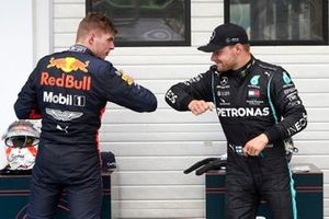Valtteri Bottas, Mercedes-AMG Petronas F1, bumps elbows with Max Verstappen, Red Bull Racing