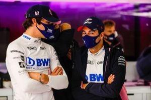 Lance Stroll, Racing Point, talks to Sergio Perez, Racing Point in the team's garage