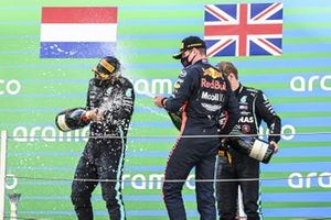 Lewis Hamilton, Mercedes-AMG Petronas F1, 1st position, Max Verstappen, Red Bull Racing, 2nd position, and Valtteri Bottas, Mercedes-AMG Petronas F1, 3rd position, celebrate on the podium