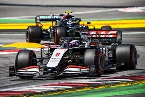 Romain Grosjean, Haas VF-20, leads Valtteri Bottas, Mercedes F1 W11 EQ Performance