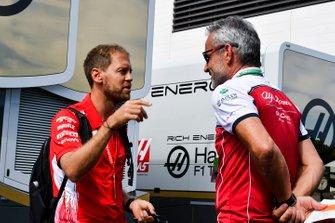 Sebastian Vettel, Ferrari and Beat Zehnder, Team Manager, Alfa Romeo Racing in the paddock
