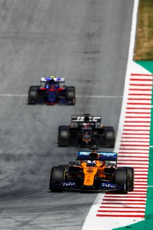 Carlos Sainz Jr., McLaren MCL34, leads Romain Grosjean, Haas F1 Team VF-19, and Alexander Albon, Toro Rosso STR14