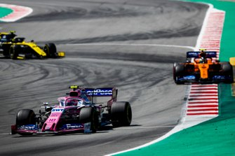 Lance Stroll, Racing Point RP19, leads Lando Norris, McLaren MCL34, and Nico Hulkenberg, Renault R.S. 19