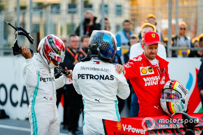 Pole man Valtteri Bottas, Mercedes AMG F1, on the grid with Lewis Hamilton, Mercedes AMG F1, and Sebastian Vettel, Ferrari, after Qualifying