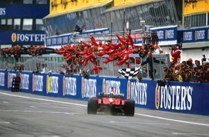 Race winner Michael Schumacher, Ferrari F2002, takes the chequered flag