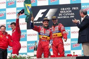 Rubens Barrichello, Jordan, 2nd position, and Jordan teammate Eddie Irvine, Jordan, 3rd position, celebrate on the podium