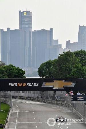 Will Power, Team Penske Chevrolet crosses the finish line under the checkered flag