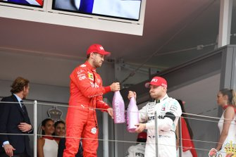 Sebastian Vettel, Ferrari, 2nd position, and Valtteri Bottas, Mercedes AMG F1, 3rd position, celebrate on the podium