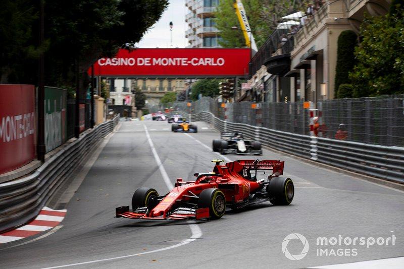Charles Leclerc, Ferrari SF90, leads Romain Grosjean, Haas F1 Team VF-19