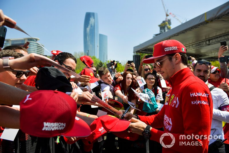 Charles Leclerc, Ferrari signs a autograph for a fan