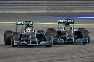 Lewis Hamilton, Mercedes W05, battles with Nico Rosberg, Mercedes W05