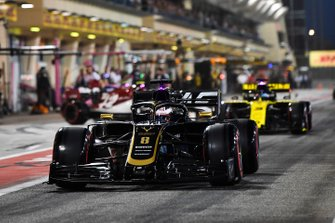 Romain Grosjean, Haas F1 Team VF-19, leads Daniel Ricciardo, Renault R.S.19, in the pit lane
