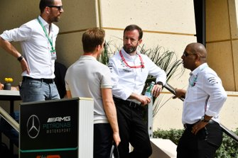 Nico Rosberg, talks to his former team mates