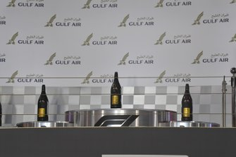 The Champagne bottles on the podium