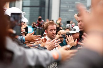 Sam Bird, Envision Virgin Racing passes through the crowd of fans to the podium