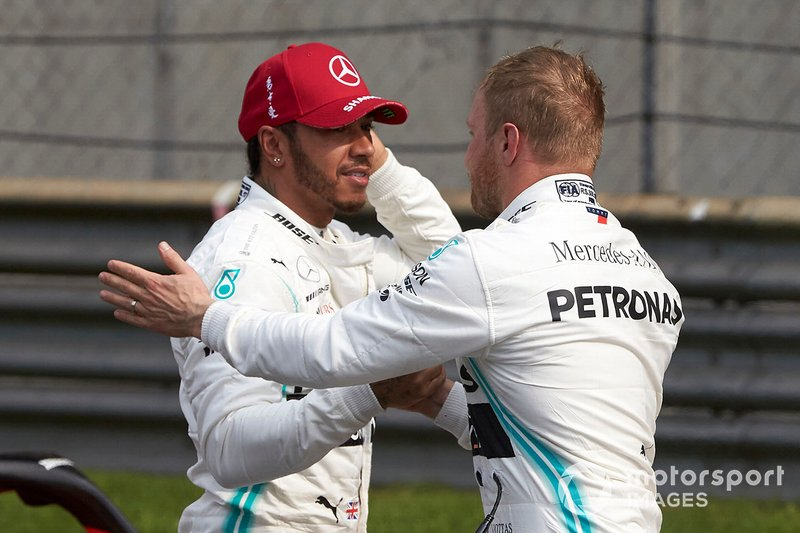Lewis Hamilton, Mercedes AMG F1, and pole man Valtteri Bottas, Mercedes AMG F1, congratulate each other