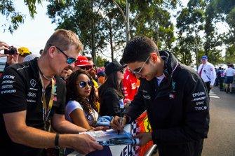 Esteban Ocon, Mercedes AMG F1 signs an autograph for a fan.