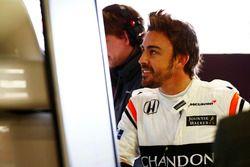 Fernando Alonso, McLaren, examines data in the garage