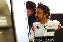 Fernando Alonso, McLaren, examines data in the garage