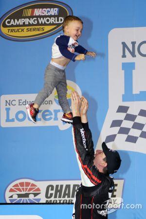 Race winner Kyle Busch, Kyle Busch Motorsports Toyota, tosses his son, Brexton, in the air
