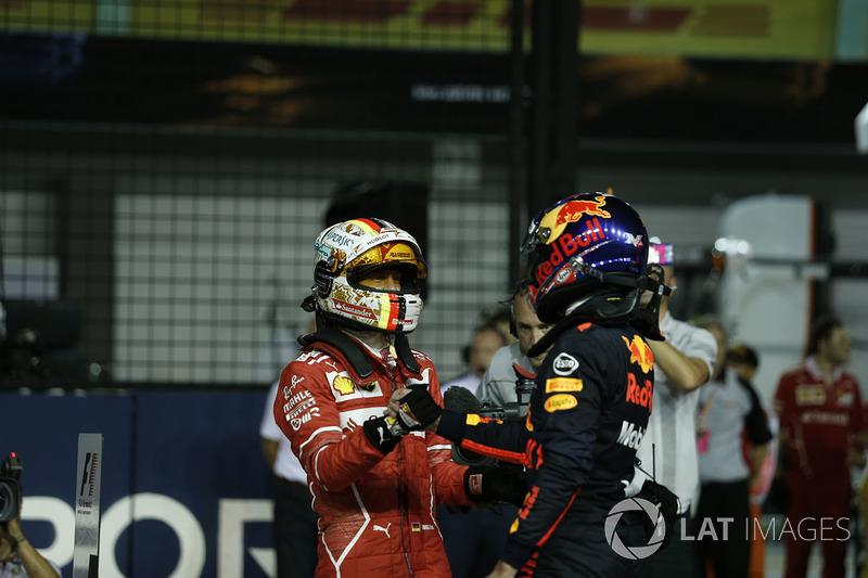 Il Poleman Sebastian Vettel, Ferrari, festeggia nel parco chiuso, Max Verstappen, Red Bull Racing