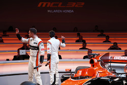 Race drivers Stoffel Vandoorne and Fernando Alonso acknowledge guests at the launch of the McLaren M