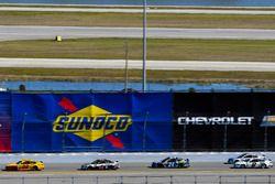 Joey Logano, Team Penske Ford, Kevin Harvick, Stewart-Haas Racing Ford and Chase Elliott, Hendrick Motorsports Chevrolet