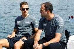 Stoffel Vandoorne, McLaren, sits next to Matt Morris, Engineering Director, McLaren, on the rowing l