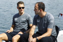 Stoffel Vandoorne, McLaren, sits next to Matt Morris, Engineering Director, McLaren, on the rowing lake