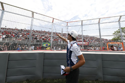 Lance Stroll, Williams, throws hats to fans