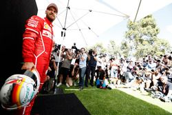 Sebastian Vettel, Ferrari, poses for photographers