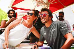 Fernando Alonso, McLaren, has his photo taken with a fan
