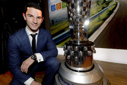 2016 Indy 500 winner Alexander Rossi looks at his face on the Borg-Warner trophy