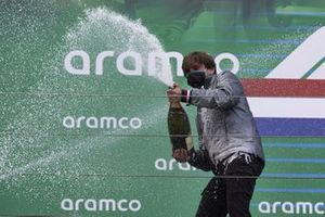 Steven Lord, Mercedes, sprays Champagne after receiving the Constructors trophy on the podium
