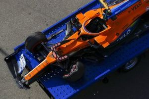The damaged car of Carlos Sainz Jr., McLaren MCL35, on a truck