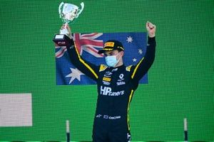 Oscar Piastri, Prema Racing celebrates on the podium with the trophy