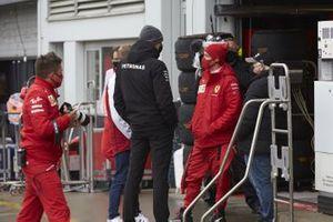 Sebastian Vettel, Ferrari and Toto Wolff, Executive Director (Business), Mercedes AMG talking