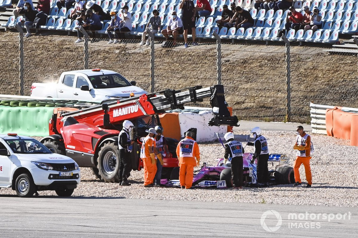 Marshals remove the car of Lance Stroll, Racing Point RP20, after a collision with Max Verstappen, Red Bull Racing RB16, during FP2