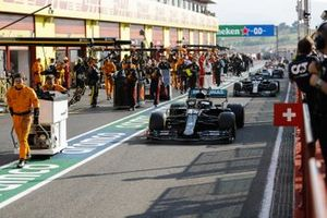 Lewis Hamilton, Mercedes F1 W11, Valtteri Bottas, Mercedes F1 W11, out of the pits for the restart