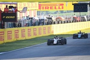 Christian Lundgaard, ART Grand Prix, leads Juri Vips, Dams, as they take the chequered flag
