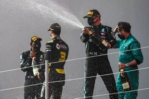 Lewis Hamilton, Mercedes-AMG F1, 1st position, Daniel Ricciardo, Renault F1, 3rd position, and Valtteri Bottas, Mercedes-AMG F1, 2nd position, celebrate with Champagne on the podium