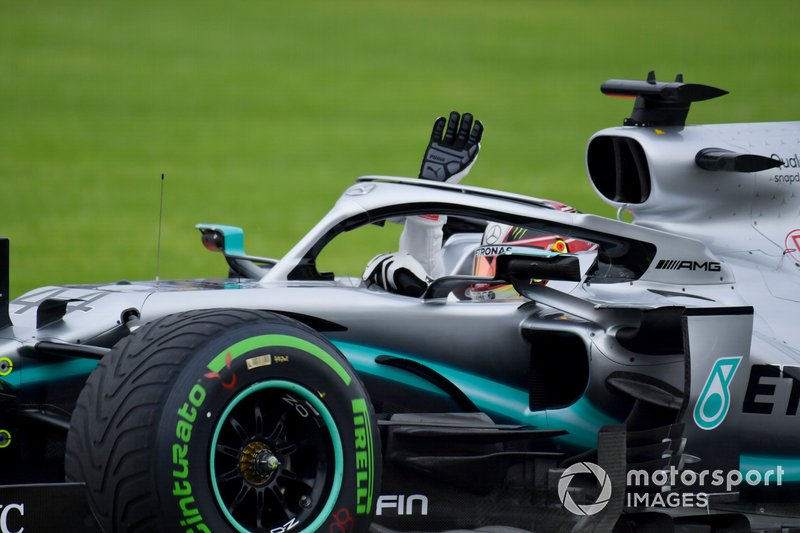 Lewis Hamilton, Mercedes AMG F1 W10, waves to fans from the cockpit