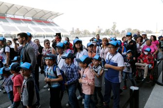 Children in the pit lane duting the community tour