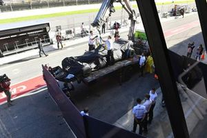 Lewis Hamilton's Mercedes F1 W11 is returned to the pits