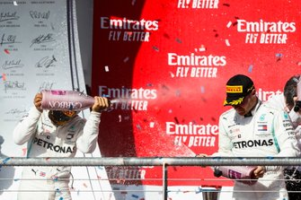 Lewis Hamilton, Mercedes AMG F1, and Valtteri Bottas, Mercedes AMG F1, celebrate on the podium