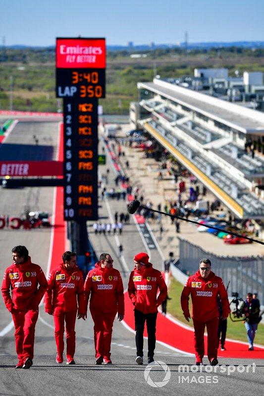 Charles Leclerc, Ferrari, walks the track
