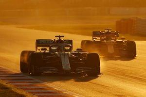 Lewis Hamilton, Mercedes F1 W11 EQ Power+, leads Carlos Sainz, McLaren MCL35