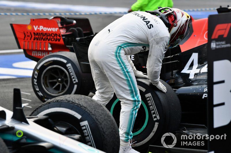 Lewis Hamilton, Mercedes AMG F1, 1st position, inspects his rear tyre in Parc Ferme